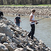 JOED VIERA/STAFF PHOTOGRAPHER-Lockport, NY-Dennis Page, Brittany Page and Mike Licht fish along the Canal.