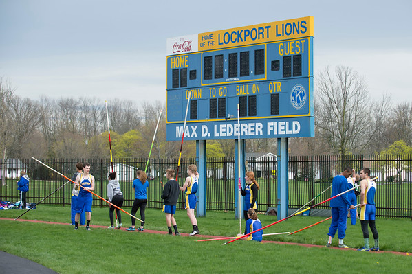 JOED VIERA/STAFF PHOTOGRAPHER-Lockport, NY- Lockport pole vaulters wait for the track and field event to start at Max D. Lederer Field.