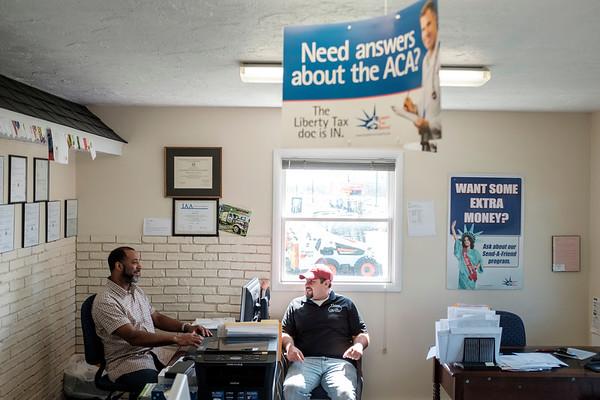 JOED VIERA/STAFF PHOTOGRAPHER-Lockport, NY-Liberty Tax owner Edwin Garey speaks with customer David Keleher.