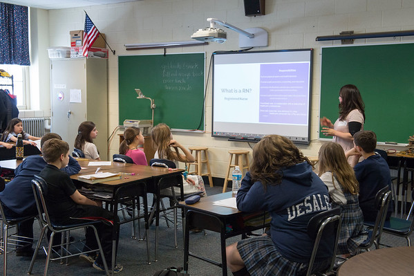 JOED VIERA/STAFF PHOTOGRAPHER-Lockprot, NY- Desale students watcha presentation by RN Michelle Genewick during their career fair.