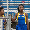 JOED VIERA/STAFF PHOTOGRAPHER-Lockport, NY- Kahniya James, 13, right, and her teammate Jordan Taylor relax after the girls 100m dash during the track and field event at Max D. Lederer Field. James won handily.