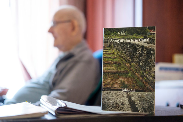 "JOED VIERA/STAFF PHOTOGRAPHER-Gasport, NY-Author John Cull's latest publication ""Song of the Erie Canal"" in his residence at Absolut Care of Gasport."
