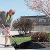 JOED VIERA/STAFF PHOTOGRAPHER-Lockport, NY-Bill Mayberry turns soil over in a flower bed in the Locks District.