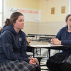 JOED VIERA/STAFF PHOTOGRAPHER-Lockprot, NY- Desales students Delaney Adams and Madison Abbott watch a presentation by Coast Guardsmen Eric Mazurek  during their career fair.