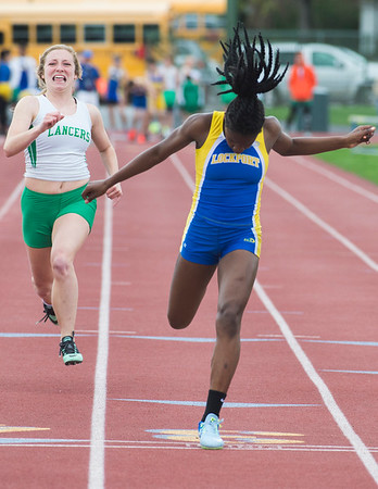 JOED VIERA/STAFF PHOTOGRAPHER-Lockport, NY- Kahniya James, 13, center, wins the girls 100m handily during the track and field event at Max D. Lederer Field.