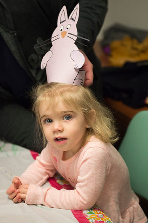 JOED VIERA/STAFF PHOTOGRAPHER-Lockport, NY- Natalia Wittcop, 2, wears a easter bunny hat she made during crafts at the Lockport Public Library.