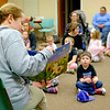 "JOED VIERA/STAFF PHOTOGRAPHER-Lockport, NY-Buffalo Zoo Outreach Program specialist Robin Sanecki read ""Quiet Bunny"" to a packed Lockport Library Community Room during the Zootales program. Afterwards children had the opportunity to pet Benjamin, a holland lop rabbit."