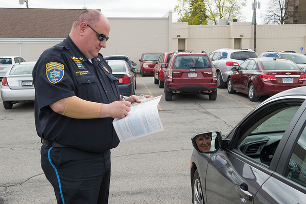 "JOED VIERA/STAFF PHOTOGRAPHER-Lockport, NY-  Niagara County Sheriffs dispatcher Roger Yurek looks over Angie Blackley's vehicle. during the CarFit event at the Dale Association on Wednesday afternoon. Yurek said that drivers are afraid that CarFit technicians are out to take their licenses ""Thats not what we do"" he said. CarFit techs inspect older drivers' vehicles to ensure they are properly adjusted for safety."