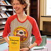 JOED VIERA/STAFF PHOTOGRAPHER-Lockport, NY- Karen Eichler of Defiant Monkey hold the groups new book in the Wheeler Room of the Lockport Public Library.