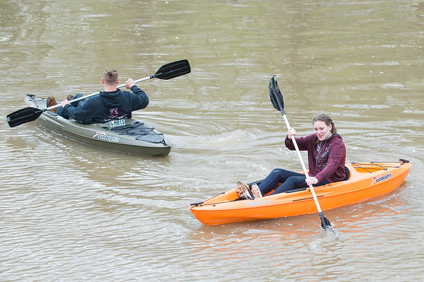 JOED VIERA/STAFF PHOTOGRAPHER-Lockport, NY-Chris Baldwin, 21, and Jessica Chase, 15, kayak down the Erie Canal after rains died down Tuesday evening.