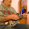 JOED VIERA/STAFF PHOTOGRAPHER-Royalton, NY-Higher Mountain'sBob Gnann and Charlie Kesterson plays his mandolin in the Kesterson's living room.