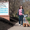 JOED VIERA/STAFF PHOTOGRAPHER-Lockport, NY-April Leiser walks her dogs past Eastern Niagara Hospital on East Ave.