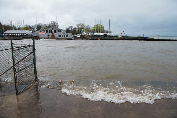 JOED VIERA/STAFF PHOTOGRAPHER-Olcott NY- Lake Ontario's water washes over an Olcott Pier.  Local officials called for a State of Emergency in Niagara County.