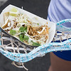 JOED VIERA/STAFF PHOTOGRAPHER-Lockport,NY- Susana Duarte Angel, 13, holds her chicken tacos from Lloyd's Taco truck in her stick.