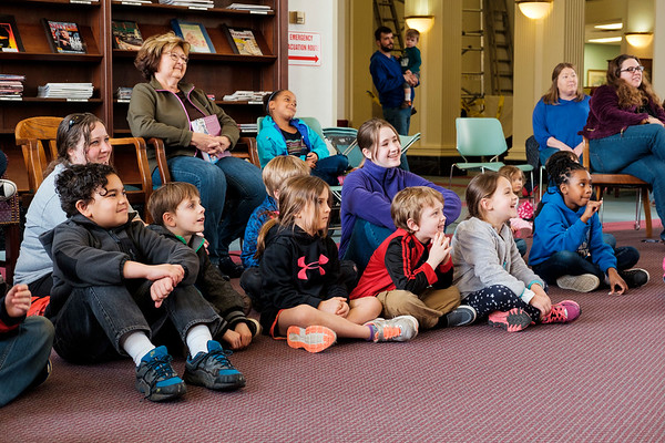 JOED VIERA/STAFF PHOTOGRAPHER-Lockport, NY-Kids sit on the floor laughing at the Defiant Monkey improv group in the Wheeler Room of the Lockport Public Library.