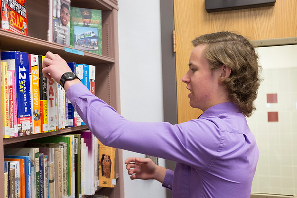 JOED VIERA/STAFF PHOTOGRAPHER-Barker, NY- Barker High School senior Josh Richbart looks through SAT books in the school library.