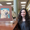 JOED VIERA/STAFF PHOTOGRAPHER-Wilson, NY-Wilson High School senior Jennifer Darlak, 18, stands by a portrait of her dog Maddi made in colored pencil. Darlak entered the drawing into Wilson High School's 15th Annual Art Show.