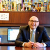 JOED VIERA/STAFF PHOTOGRAPHER-Lockport,NY- Lockport High School principal Frank Movalli sits at his desk.