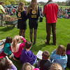 JOED VIERA/STAFF PHOTOGRAPHER-Gasport, NY-Future Farmers of America Royalton-Hartland chapter president Madeline Keyes, 17,  and secretary Delaney Draper, 17, discuss the importance of Earth Day and Arbor day alongside their FFA advisor Matthew Sweeney before watching the planting of a 6 year old Sycamore tree in front of  Royalton-Hartland Elementary School as a part of their Arbor Day celebration. Each student in Pre-K through 4th grade took home a Blue Spruce Seedling to plant. In the past four years the school has distrubuted more than 2,000 spruces to students.