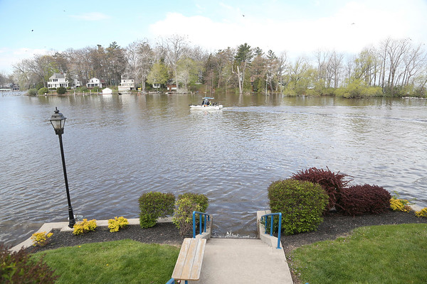STEPHEN M. WALLACE/CONTRIBUTER- Wilson, NY- The walk way at Wilson Pier is submerged by Lake Ontario's rising waters.
