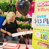 JOED VIERA/STAFF PHOTOGRAPHER-Lockport, NY- Amy Hanssen-Keyes and her husband David Keyes pick up a $10,000 check from Tops. The couple won the prize after a recent visit to the store as an instant prize from the supermarket chain's Monopoly game. Hanssen-Keyes says that they play Monopoly every year but this is the first time they've won. The couple's son Clayton usually collects the all the pieces for the family. Although the store has had other winners, $10,000 is the largest cash prize the Transit Road store has ever rewarded. Tops' collect and win game continues through June 17th.