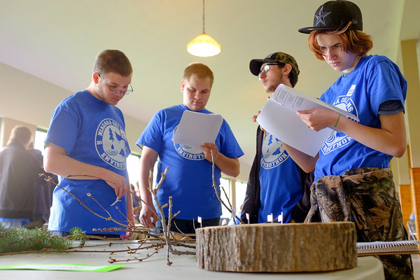 JOED VIERA/STAFF PHOTOGRAPHER-Lewiston, NY-  Niagara BOCES students Luke Plandowski, 16, Jacob Gromlovits, 17, Corbin Walerowicz, 16, and Selena Witkorf, 16, look over the forestry section of the  28th Regional Envirothon competition at Bond Lake Park Nature Center