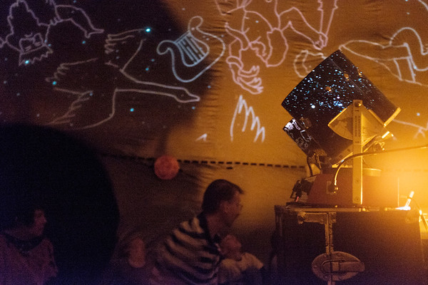 JOED VIERA/STAFF PHOTOGRAPHER-Royalton, NY-Last Thursday and Friday, Desales Catholic School students were treated to a field trip and they didn't even have to leave their school. Students in pre-school to eighth grade saw an excellent representation of the stars when the Mr. K's Mobile Dome Planetarium set up in the School's old library. Planetarium instructor and owner Paul Krupinski led each class through personalized and instructive viewings of the night sky.