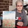 JOED VIERA/STAFF PHOTOGRAPHER-Lockport, NY-Beverly Linderman sells paper poppies to Transit Road Keybank customers for the VFW Buddy Poppy Program.