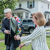 JOED VIERA/STAFF PHOTOGRAPHER-Lockport, NY-American Legion 410 post commander and Lockport Mayor Anne McCaffrey lay a wreath down during a Memorial Day ceremony at Veterans Park.