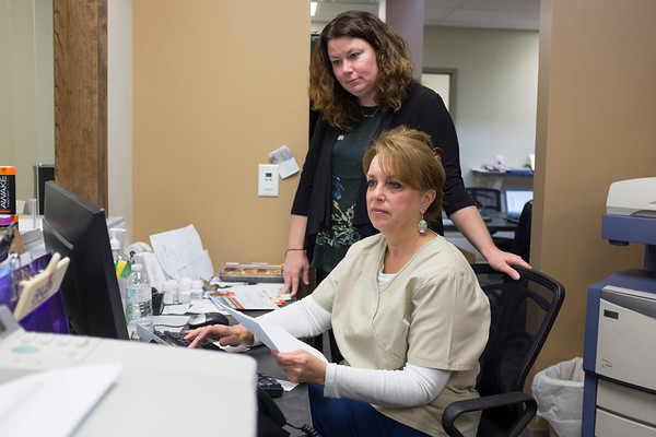 JOED VIERA/STAFF PHOTOGRAPHER-Pendleton, NY-Dr. Patricia Danaher works behind her medical assistant Pamela Adinolfe at their new office on Campbell Blvd.