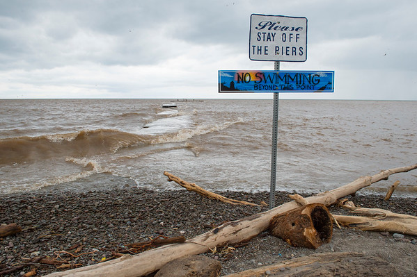 JOED VIERA/STAFF PHOTOGRAPHER-Olcott, NY-  Lake Ontario waves crash over  a pier at Olcott Beach in this file photo from May 2nd.