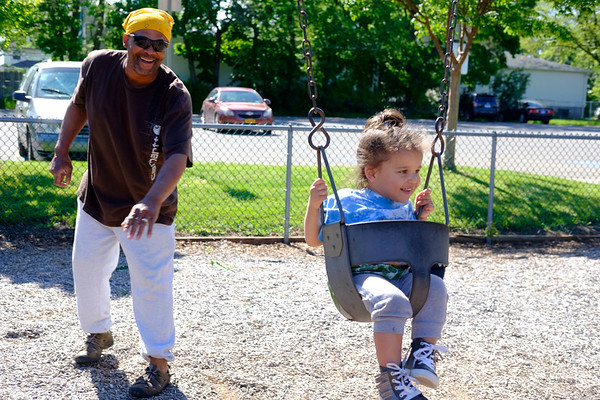 JOED VIERA/STAFF PHOTOGRAPHER-Lockport, NY-George Payne pushes his daughter Arebella, 2, on a swing at Altro Park on Willow Street.