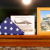 JOED VIERA/STAFF PHOTOGRAPHER-Lockport, NY-  A flag flown with Sgt. Timothy LeBar out of a Black Hawk Helicopter while deployed in Iraq sits on a mantle next to a picture of the 32 year-old veteran.