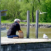 JOED VIERA/STAFF PHOTOGRAPHER-Lockport, NY-  Mark Udell looks out towards the canal after a late afternoon meal at Nelson C. Goehle Marina