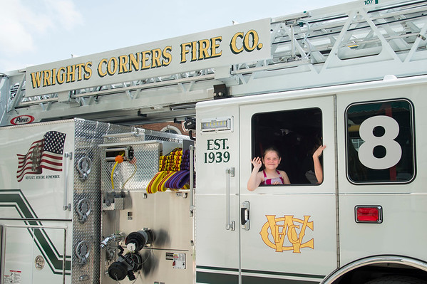 JOED VIERA/STAFF PHOTOGRAPHER-Lockport, NY-A girl waves from a Wrights Corners fire engine during Lockport's Memorial Day Parade.