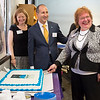 JOED VIERA/STAFF PHOTOGRAPHER-Lockport NY-Lockport Challenger Center Director Kathy Michael cuts a celebratory cake as during the Center's grand opening.