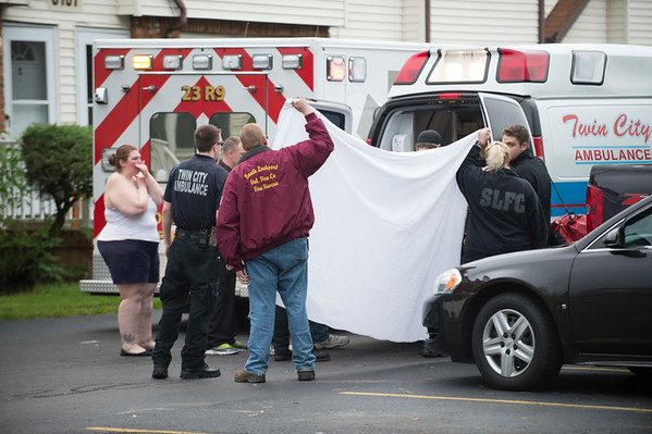 JOED VIERA/STAFF PHOTOGRAPHER-Lockport, NY-Emergency crews work the scene of a child falling from a window on Strauss Road.