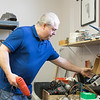 JOED VIERA/STAFF PHOTOGRAPHER-Lockport,NY-Bear Bottom Wholesale owner Larry Breyer organizes the tool area at their new location. The shop moved from Harrison Place to the former Ultimate Physique location on April 29th. Breyer said the new location has more than double the space.  Bear Bottom buys most of it's wares from estate sales and offers everything in their store at prices that are negotiable. Check out their new location at 20 Ann Street in Lockport