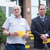 JOED VIERA/STAFF PHOTOGRAPHER-Lockport, NY-George McKinney stands holding a yellow dot pamphlet with assemblyman Mike Norris outside of the Dale Association. The Yellow Dot program is devised to inform emergency personnel of a driver's and passengers' vital health information in event of emergency on road. Participants place a yellow sticker on their vehicles so if they are pulled over, law enforcment instantly know where to look for information.  Kits were  distributed through a partnership with the Niagara County Sheriffs Office. To participate in the program contact assemblyman Norris' office at 716-839-4691.