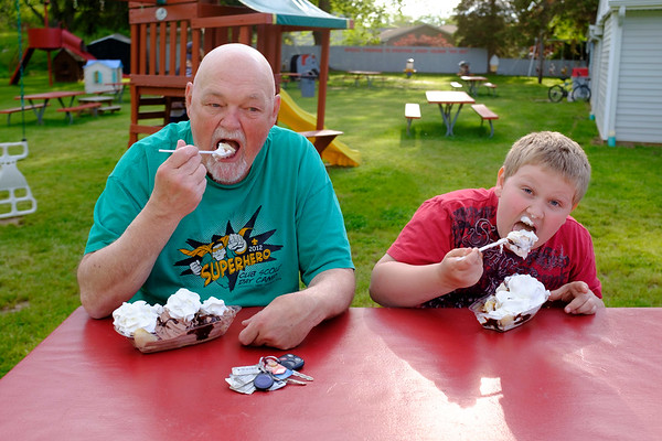 JOED VIERA/STAFF PHOTOGRAPHER-Lockport, NY-Anthony and his son Aidan Shay, 8, enjoy banana splits behind Widewaters.