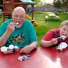 JOED VIERA/STAFF PHOTOGRAPHER-Lockport, NY-Anthony and his son Aidan Shay, 8, enjoy banana splits behind Widewaters.