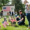 JOED VIERA/STAFF PHOTOGRAPHER-Lockport, NY- Army Veteran Jordan Mattiuzzo and his wife Heather lay down flowers on the grave of  Jordan's great uncle Justin D'Augustino after the memorial service at Cold Springs Cemetery. D'Augustino, died in the pacific while serving in the Navy during  WW2.