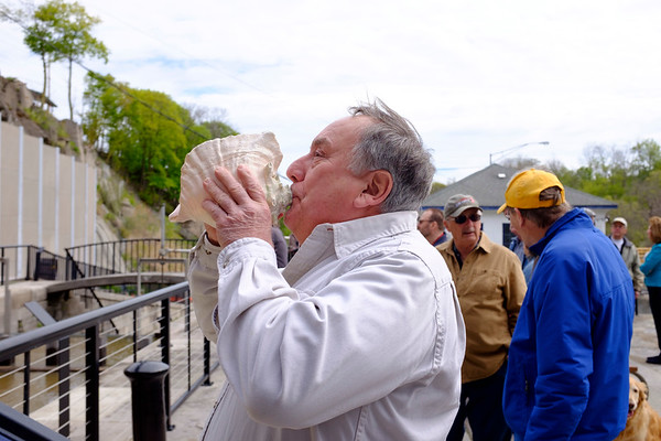 JOED VIERA/STAFF PHOTOGRAPHER-Lockport, NY-Volunteer boat builder Skip Hauenstein test out his conch before the Erie Traveler is set into the Flight of Five.