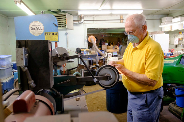 JOED VIERA/STAFF PHOTOGRAPHER-Lockport, NY-  Roger Bil grinds down the blade of a knife he is making in his workshop.