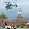 JOED VIERA/STAFF PHOTOGRAPHER-Lockport, NY-Mercy flight carrys an injured child that fell from the second story of Emmett Belknap Intermediate School Monday afternoon.