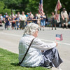 JOED VIERA/STAFF PHOTOGRAPHER-Lockport, NY-Mary Shirbach holds a flag while sitting at East Avenue watching Lockport's Memorial Day Parade.
