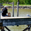 JOED VIERA/STAFF PHOTOGRAPHER-Lockport, NY-  Mark Udell takes a bite of his apple during a late afternoon meal at Nelson C. Goehle Marina