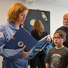 JOED VIERA/STAFF PHOTOGRAPHER-Lockport NY-Jocelyn Welton goes over the what the Challenger Center offers with facinated 11-year-old Kai Schiesel and his grandfather Jim Gleason