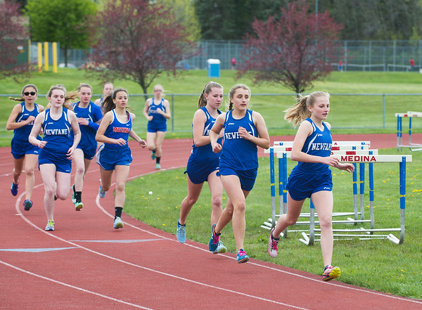 JOED VIERA/STAFF PHOTOGRAPHER-Medina NY-Newfane and Medina High Schools compete in a track meet on the Mustangs home turf.