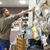 JOED VIERA/STAFF PHOTOGRAPHER-Lockport,NY-Isaiah Bullock checks out the selection at Bear Bottom Wholesale's new location. The shop moved from Harrison Place to the former Ultimate Physique location on April 29th. Owner Larry Breyer said the new location has more than double the space.  Bear Bottom buys most of it's wares from estate sales and offers everything in their store at prices that are negotiable. Check out their new location at 20 Ann Street in Lockport